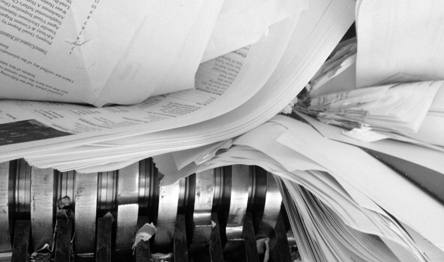 on site shredding service - documents and files being shredded