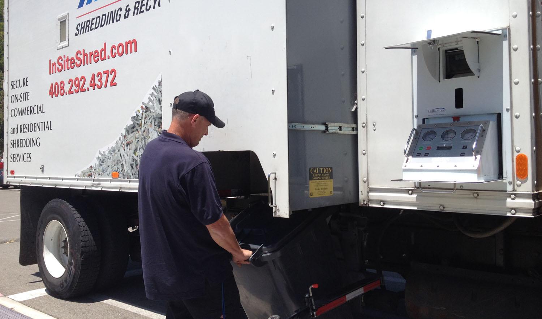 on site shredding service - loading paper bins onto truck